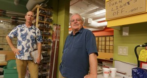"Architect Scott Wende, right, joins Kendall's Ace Hardware owner Kendall Crosby at the store he designed two years ago following the state's B3 guidelines. ""What we always liked about B3 was it was performance-based in terms of energy use, and LEED was about products,"" Wende said. "" … We liked the system better than other sustainability guideline programs."" (Staff photo: Bill Klotz)"