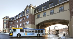 Buses exit under an arch built through the 104-unit Oaks Station Place Apartments, at 46th Street and Hiawatha Avenue in Minneapolis. (Staff photo: Bill Klotz)