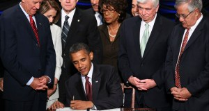 The tighter rules governing bonds were mandated by the Dodd-Frank Act after investors were burned by soured debt sold by Wall Street before the 2008 credit crisis. In this photo, President Barack Obama signs the Dodd-Frank Act on July 21, 2010. (Bloomberg News file photo)