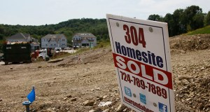 The Commerce Department reported Wednesday that U.S. sales of new homes climbed 18 percent in August to a seasonally adjusted annual rate of 504,000. This photo shows construction underway Sept. 10 at a housing development in Zelienople, Pa. (AP file Photo: Keith Srakocic)