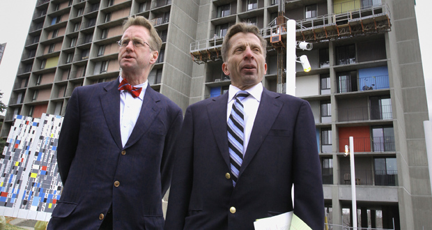 George Sherman, right, principal with Sherman Associates, said his company provided 700 parking spaces for more than 1,300 units when it completed a rehab of the Riverside Plaza in Minneapolis. The complex's Cedar-Riverside neighborhood is served by both of the region's light rail lines, as well as buses. (File photo: Bill Klotz)