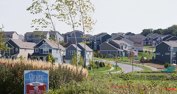 Randal O'Toole, senior fellow at the Cato Institute, said regulations that attempt to mandate density and limit sprawl are futile since most people want single-family homes like the ones shown here in Pulte Homes' Dancing Waters development in Woodbury. Myron Orfield, a University of Minnesota professor, counters that land-use regulations are necessary to use scarce resources responsibly. (File photo: Bill Klotz)