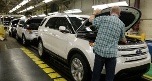 Workers perform final inspections on 2015 Ford Explorers on Oct. 22 on the assembly line at the Chicago Ford Assembly Plant in Chicago. The Commerce Department reported that orders for durable goods fell in September. (AP Photo: M. Spencer Green)