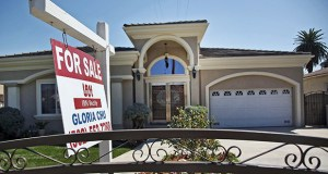 "A ""For Sale"" sign is posted on a home Sept. 11 in Monterey Park, Calif. The National Association of Realtors said Tuesday that sales of existing homes rose 2.4 percent in September from the previous month. (AP Photo: Nick Ut)"