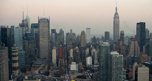The real-estate industry is fighting against a proposed New York levy on non-resident owners of apartments valued at more than $5 million. The measure would raise about $665 million annually. This photo shows the New York skyline in December 2013. (Bloomberg file photo)