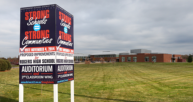 Rogers High School, at 21000 141st Ave. in Rogers, will get a new classroom wing and auditorium if voters approve a $98.03 million bond referendum next week. (Staff Photo: Bill Klotz)