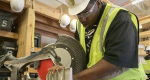 Student Dante Hall uses a miter saw during a Summit Academy OIC carpentry class. Minnesotans from minority groups offer employers the biggest pool of untapped labor in a job market that's rapidly tightening because of demographic changes. (Staff photo: Bill Klotz)