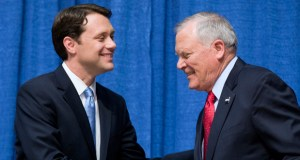 Georgia Gov. Nathan Deal, right, shakes hands with Democratic opponent Jason Carter following a debate in Perry, Ga. Carter, grandson of former President Jimmy Carter, sharply blamed the governor for Georgia's 8.1 percent unemployment rate. (AP photo)
