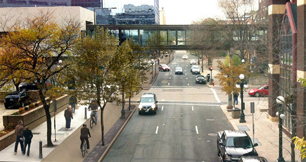 A rendering shows a bike and pedestrian trail separated from vehicle traffic on Jackson Street in downtown St. Paul. The trail is part of an off-road bike and pedestrian loop planned throughout the downtown area. (Submitted rendering: City of St. Paul)