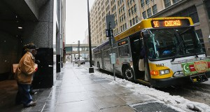 A bus stop is pictured on Eighth Street S. between LaSalle and Nicollet avenues. The city of Minneapolis hopes to reconstruct a 0.72-mile portion of Eighth Street and include wider sidewalks at bus stops. (Staff photo Bill Klotz)