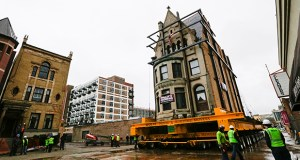 Crews watch as the Harriet Rees House, a three-story, 762-ton Chicago mansion built in 1888, is moved slowly to a new location Tuesday on the city's historic Prairie Avenue to make room for redevelopment Tuesday, Nov. 11, 2014. (AP Photo: Teresa Crawford)