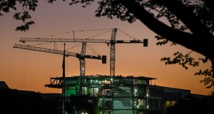 Construction cranes are silhouetted against the early morning sky Oct. 8 as work continues on Smithsonian's new National Museum of African American History and Culture in Washington. The Commerce Department reported Monday that construction spending fell in September for a second straight month. (AP Photo: J. David Ake)