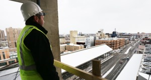 Jon Fletcher of Alatus LLC looks off toward Washington Avenue from the sixth story of Latitude 45, a 13-story, 319-unit apartment project under construction at 301 Washington Ave. S. in Minneapolis. (Staff photo: Bill Klotz)
