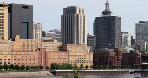 The Ramsey County Government Center West (left) is a complex made up of six separate buildings. The red brick building to the right is the former Adult Detention Center. All the buildings sit vacant on the edge of downtown St. Paul with views of the Mississippi River. (File photo: Bill Klotz)