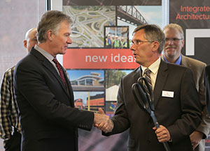 St. Paul Mayor Chris Coleman, left, and TKDA president and CEO Bill Deitner celebrate the newly completed expansion and renovation of TKDA's headquarters Thursday. TKDA occupies 54,000 square feet in the UBS Plaza, 444 Cedar St., St. Paul. (Staff photo: Bill Klotz)
