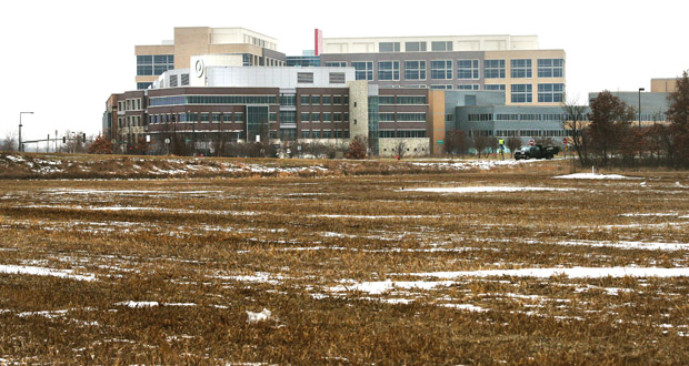 Bloomington-based Doran Cos. plans to buy 11 acres of vacant Brooklyn Park farm land and build 500 apartments there, pending city approval. The site is just southeast of Target Corp.'s Northern Campus (in the background). (Staff photo: Bill Klotz)
