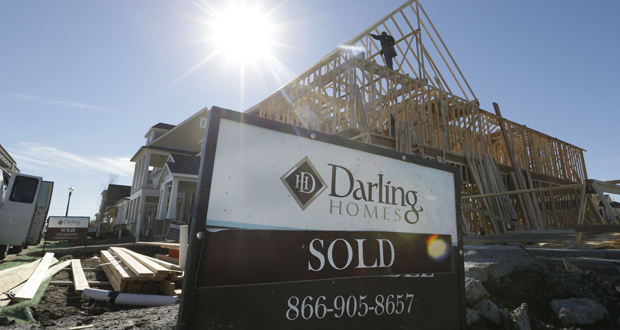 A sold sign sits in front of a house under construction Monday in Coppell, Texas. Construction of new homes fell slightly in November, reflecting weakness in construction of single-family homes. (AP Photo: LM Otero)
