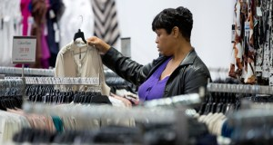 A woman shops Oct. 28 at the Century 21 Department Store in Philadelphia. The Commerce Department reported Thursday that retail sales rose a seasonally adjusted 0.7 percent in November. (AP Photo: Matt Rourke)