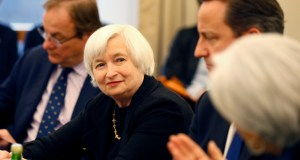 """Federal Reserve Chair Janet Yellen, left, is acknowledged Jan. 15 by International Monetary Fund  Managing Director Christine Lagarde, right, with British Prime Minister David Cameron, during a roundtable meeting at the IMF in Washington. The Federal Reserve reiterated Wednesday after its latest plicy meeting that it will be """"patient"""" in raising interest rates. (AP File Photo)"""