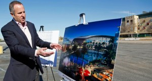 Chris Meany, senior vice president of Hollywood Park Land Company, unveils an architectural rendering of a proposed NFL stadium Jan. 5 at Hollywood Park in Inglewood, California. (AP photo)