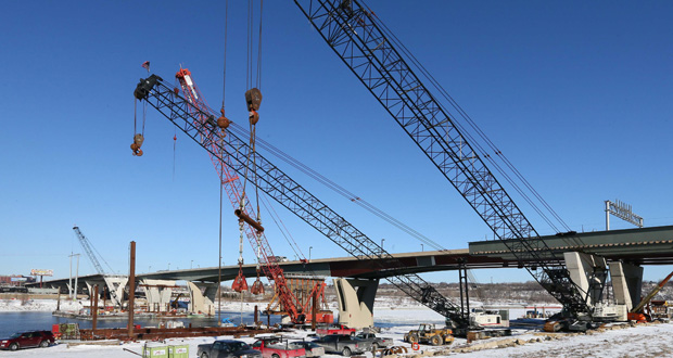 As construction continues on the $130.4 million Lafayette Bridge over the Mississippi River in St. Paul, Senate DFLers hope to use a sales tax on gasoline, higher fees, and bonding to pay for road, bridge and transit projects. (Staff Photo: Bill Klotz)
