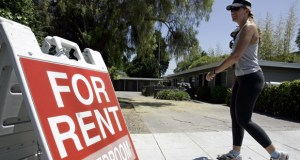 "A woman walks next to a ""For Rent"" sign July 19, 2006 at an apartment complex in Palo Alto, California. Real estate data firm Zillow reported Friday thathome rental prices rose 3.3 percent in December compared with 12 months earlier. (AP file photo)"