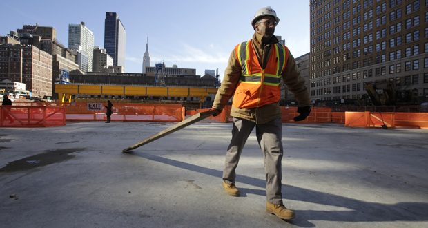 A construction worker clears wood Nov. 18 from a platform that spans the Penn Station railroad tracks in midtown Manhattan, in New York. The Institute for Supply Management, a trade group of purchasing managers, reported Tuesday that services firms expanded at a slower pace in December compared with the previous month. (AP file photo)