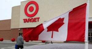 A Canadian flag flies on the car of a customer's car parked in front of a Target store in Guelph, Ontario, in this March 2013 photo. (AP photo: The Canadian Press)