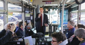 Metropolitan Council Chair Adam Duininck speaks to passengers on a bus tour of a new bus rapid transit corridor between St. Paul and Woodbury. (Staff photo: Bill Klotz)