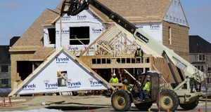 Crews work Thursday on a new house within a Ryland Homes development off Vicksburg Lane North in Plymouth. The city led the metro area in February homebuilding permits. (Staff photo: Bill Klotz)
