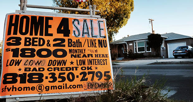 A sign advertises a house for sale Jan. 17 in Los Angeles. Standard & Poor's reported Tuesday that the S&P/Case-Shiller 20-city home price index increased 4.5 percent in December compared with 12 months earlier. (AP Photo: Richard Vogel)