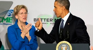 Sen. Elizabeth Warren, D-Mass. applauds as President Barack Obama arrives to speak at AARP headquarters Monday in Washington. (AP photo)