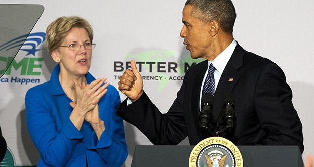 Sen. Elizabeth Warren, D-Mass. applauds as President Barack Obama arrives to speak at AARP headquarters Monday in Washington. (AP photo)