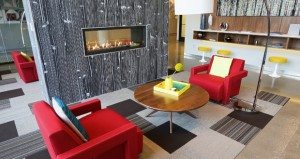 The lobby of the Red 20 apartments in northeast Minneapolis offers a gas fireplace and art from the local creative community. (Staff photos: Bill Klotz)