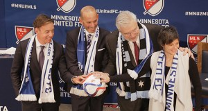 Members of an ownership group and Major League Soccer Commissioner Don Garber line up Wednesday at a press event announcing plans to bring a soccer franchise to Minnesota. From left to right: Robert Pohlad, Garber, Bill McGuire and Wendy Carlson Nelson. (Staff photo: Bill Klotz)