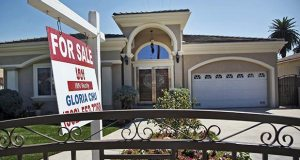 A for sale sign is posted Sept. 11, 2014, on a home in Monterey Park, Calif. The National Association of Realtors reported Wednesday that sales of existing homes jumped 6.1 percent in March. (AP file photo)