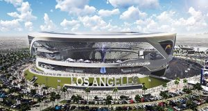 This artist's rendering shows the exterior of a newly revised plan for a proposed stadium that would house both the Chargers and the Raiders NFL football teams, here in Chargers' home game configuration, in Carson, Calif. The thoroughly revamped stadium renderings for the $1.7 billion joint stadium planned by the two teams were released Thursday. (Manica Architecture/Carson2gether via AP)