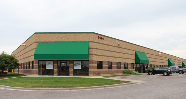 This office warehouse at 9464-9496 Hemlock Lane N. is one of three adjacent buildings Interstate Partners purchased as part of a $9 million portfolio acquisition in the Five Star Commerce Center in Maple Grove. (Submitted photo: CoStar)