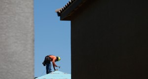 A worker helps to frame a new home April 13 at a housing tract in Las Vegas. The National Association of Home Builders/Wells Fargo builder sentiment index released Monday slipped this month to 54, down two points from 56 in April. (AP Photo: John Locher)