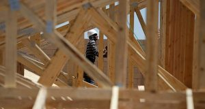 A worker helps frame a new home April 13 at a housing tract in Las Vegas. The Commerce Department reported Friday that construction spending dropped 0.6 percent in March. (AP Photo: John Locher)