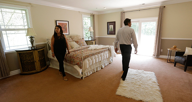Realtor Stephan Marshall, right, walks with potential buyer Sasha Martinez at a home for sale May 6 on Perez Drive in Pacifica, Calif. Among the toughest markets for homebuyers are San Jose, San Francisco and Los Angeles, as well as Seattle, Denver, Dallas-Fort Worth, Texas, Nashville and Boston, according to Zillow. In those areas, homes are selling an average of 48 days faster than properties in markets where buyers have the edge, according to Zillow. (AP Photo: Jeff Chiu)