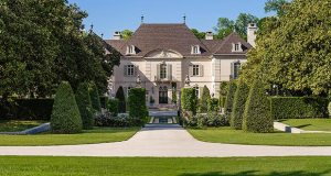 This undated photo provided by Christie's International Real Estate shows an exterior view of Walnut Place, a $100 million estate on the market in Dallas. (Stephen Reed Photography via CIRE via AP)