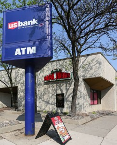 """Mortenson Development says it is """"evaluating options"""" for a mixed-use project at 333 E. Hennepin Ave. in northeast Minneapolis, now the site of a U.S. Bank branch and a Papa John's restaurant. (Staff photo: Bill Klotz)"""