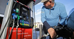 Eduardo Palacios-Paez, of Miami, pumps gas Dec. 11 at a RaceTrac gasoline station in Hialeah, Fla. Consumers have been uncharacteristically frugal, even as the country added jobs and a sharp drop in gas prices over the past year left them more money to spend. (AP file photo)