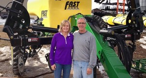 Nancy and Verlyn Fast, founders of Fast Manufacturing Inc., posed in 2014 with company equipment on their Mountain Lake farm. Later that year, the couple moved the company to a new plant in Windom and on May 18, sold the company to Glenwood-based Wasp Inc. (File photo: Bill Klotz)