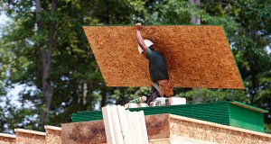 A worker carries a load of lumber to a new home construction site June 8 in Mechanicsville, Va. U.S. builders broke ground on fewer homes in May, but the pace of construction remains significantly higher than a year ago. (AP photo: Steve Helber)