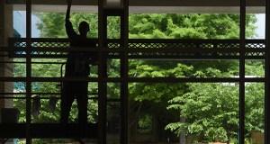Chattanooga Convention Center employees Nikesha Johnson, left, and Jeffery Schaffer clean windows May 26 at the downtown facility, in Chattanooga, Tennessee. The Conference Board reported Thursday that its index of leading indicators rose 0.7 percent in May. (AP photo: John Rawlston/Chattanooga Times Free Press)