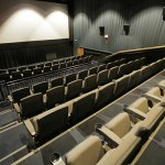 A former commercial theater space was converted into a theater for team use.