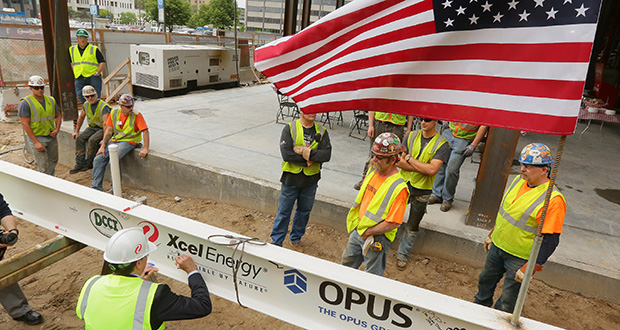 Before topping off the new Xcel headquarter in downtown Minneapolis on Thursday, about 100 construction workers signed a white beam with markers before it was hoisted to the top floor. (Staff photos: Bill Klotz)