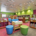 The library's children's section is filled with bright and colorful furniture.